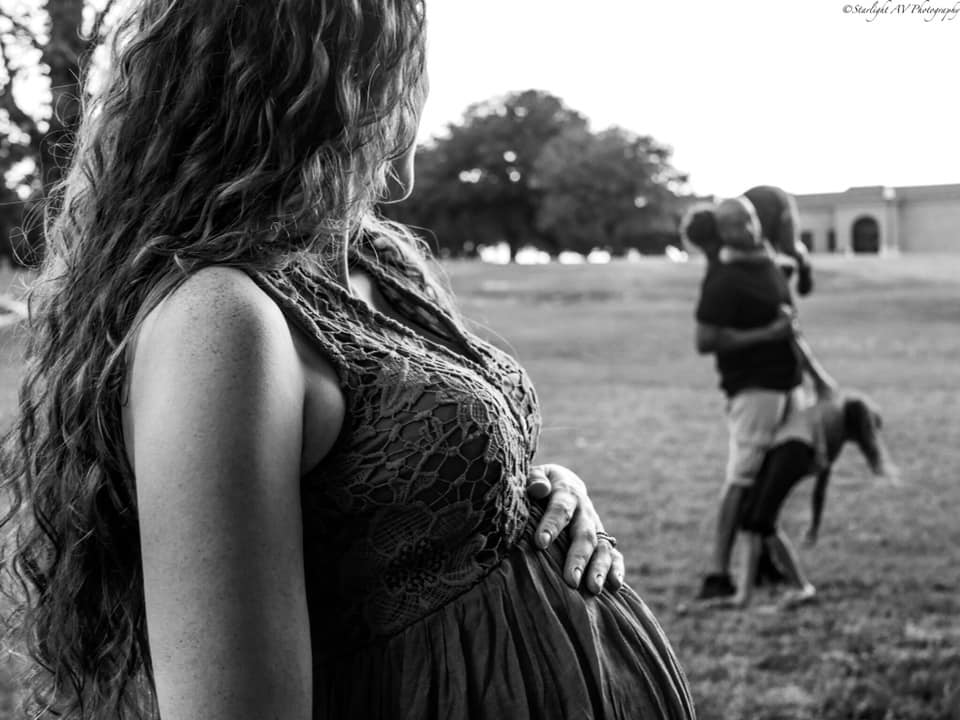 Pregnant Mama watching her family